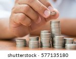 right hand putting add coin to... | Shutterstock . vector #577135180