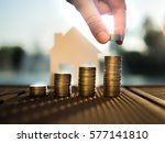 saving to buy a house that hand ... | Shutterstock . vector #577141810