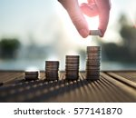 hand putting money coins stack... | Shutterstock . vector #577141870