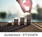hand putting money coins stack...   Shutterstock . vector #577141876