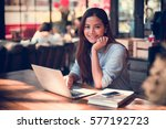 asian woman in coffee shop cafe ... | Shutterstock . vector #577192723