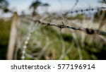 Small photo of Barbed wire fences are broken damaged with untiring patience in vintage style picture.