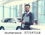 smiling businessman with... | Shutterstock . vector #577197118