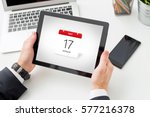 businessman holding tablet with ... | Shutterstock . vector #577216378