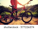 young woman riding mountain... | Shutterstock . vector #577226374