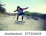 young skateboarder riding... | Shutterstock . vector #577226410