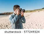 casual young man taking a photo ...   Shutterstock . vector #577249324
