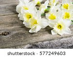 white daffodil flowers on old... | Shutterstock . vector #577249603