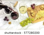 red wine poured into a glass... | Shutterstock . vector #577280200