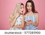 two surprised cute young women... | Shutterstock . vector #577285900