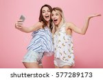 two cheerful young women with... | Shutterstock . vector #577289173