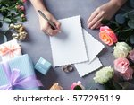 female hands writing wedding to ... | Shutterstock . vector #577295119