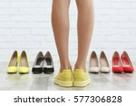 woman choosing shoes on brick... | Shutterstock . vector #577306828