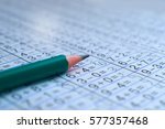 the pencil is on the notebook... | Shutterstock . vector #577357468
