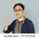 asian men adult smile thumb up... | Shutterstock . vector #577372918