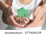 child and adult person holding... | Shutterstock . vector #577404139