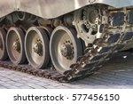 Small photo of Defense, Military tank, detail of tracks or wheels of the off-road armored vehicle