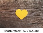 Yellow Heart On Wooden...