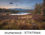 mirror surface lake autumn... | Shutterstock . vector #577475464