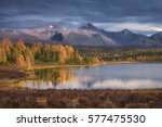 mirror surface lake beautiful... | Shutterstock . vector #577475530