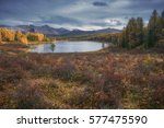 mirror surface lake... | Shutterstock . vector #577475590