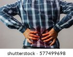men with low back pain on a... | Shutterstock . vector #577499698