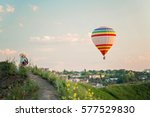 children on a hill looking at... | Shutterstock . vector #577529830