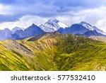 snow capped peaks and green... | Shutterstock . vector #577532410