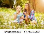 happy cute little girl blowing... | Shutterstock . vector #577538650
