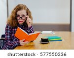 puzzled young woman in glasses... | Shutterstock . vector #577550236