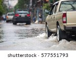 Pickup truck on a flooded street - stock photo