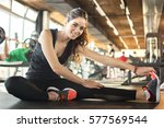 smiling sporty woman stretching ... | Shutterstock . vector #577569544