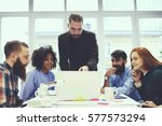 skilled male leader analyzing... | Shutterstock . vector #577573294