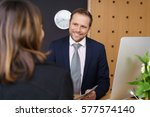 smiling hotel manager or... | Shutterstock . vector #577574140