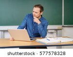 solitary teacher prepares his... | Shutterstock . vector #577578328