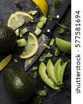 fresh avocados and lime slices  | Shutterstock . vector #577581694
