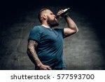 fat bearded man drinking beer... | Shutterstock . vector #577593700