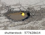 large pot hole in the road with ... | Shutterstock . vector #577628614