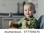 the child in the kitchen alone... | Shutterstock . vector #577704670