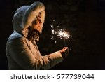 young woman holding a sparkle...   Shutterstock . vector #577739044