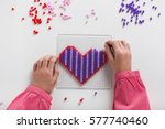 little child hands make beads... | Shutterstock . vector #577740460