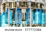 filling bottles with water | Shutterstock . vector #577772386