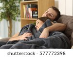 portrait of a relaxed couple... | Shutterstock . vector #577772398