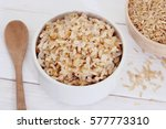 brown rice on white background | Shutterstock . vector #577773310