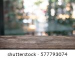image of wooden table in front... | Shutterstock . vector #577793074