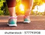 female athlete runner touching... | Shutterstock . vector #577793938