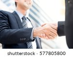 businessman making handshake... | Shutterstock . vector #577805800