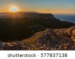Stock photo sunrise over the mountains of the southern crimea view from top of mount ilyas kaya laspi bay 577837138