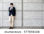 young man holding a smart phone | Shutterstock . vector #577858108