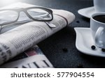 Glasses And Newspaper And Cup...